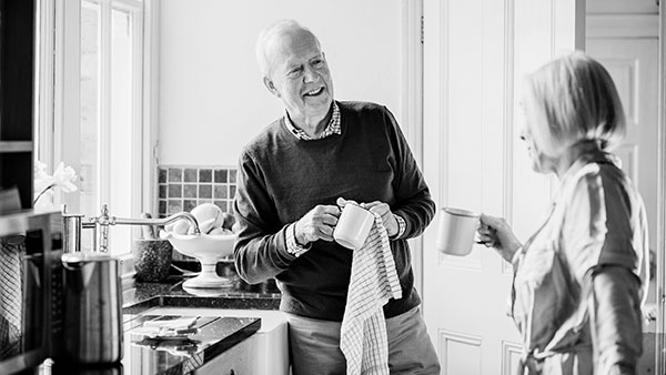 A husband helping his wife in the kitchen - Sainsbury's energy customer service